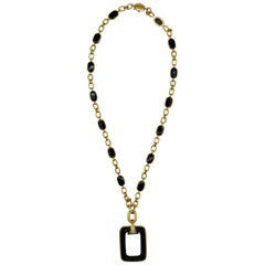 1970s Boucheron Onyx, Diamond and Gold Pendant Necklace