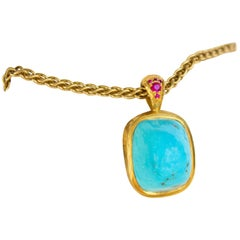 Hand Fabricated Solid Turquoise and 22 Karat Gold and Ruby Pendant