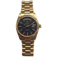 Rolex 18K Yellow Gold Day-Date President Black Dial Automatic Watch, 1970s