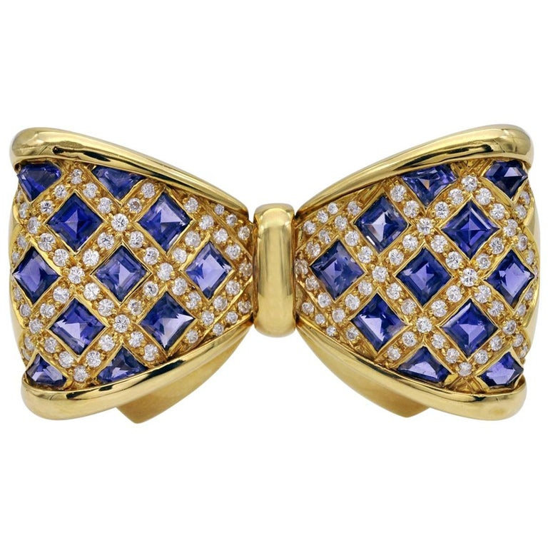 Diamond and Iolite Gold Bowtie Brooch For Sale