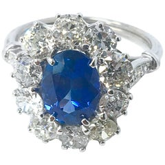 4 Carat Oval Sapphire and Diamond Ring