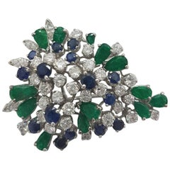 Floral Broach in 18 Karat White Gold with Diamonds Emeralds and Sapphires