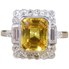 Yellow Sapphire and Diamond Engagement Ring in 18 Carat White Gold