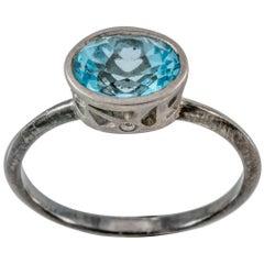 Modern Blue Topaz and Diamond Solitaire Ring