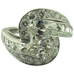 4.50 Carat Diamond cross-over ring in Platinum, circa 1960.