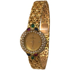 Baume & Mercier 18K Gold Lady's watch with Diamonds, Rubies, Emeralds, Sapphires
