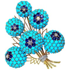 Large circa 1960s Dress Clip of Persian Turquoise, Diamonds and Sapphires