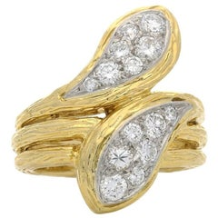 Van Cleef & Arpels Gold and Diamond Double Headed Snake Ring, circa 1970s