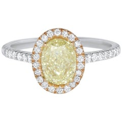 Oval 1.21 Carat Natural Fancy Yellow Diamond Halo Ring