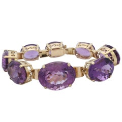 1950s Horizontal and Prong Set Oval Amethyst and Gold Link Bracelet