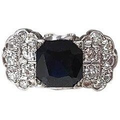 Art Deco Platinum 2.82 Carat Emerald Cut Blue Sapphire and Diamond Ring