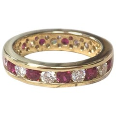 18 Karat Yellow Gold Diamonds and Rubies Eternity Ring