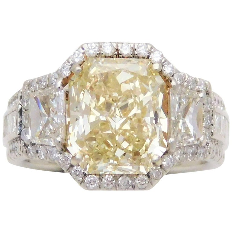 GIA Certified 7.57 Carat Handmade Radiant Cut Canary Yellow Diamond Ring