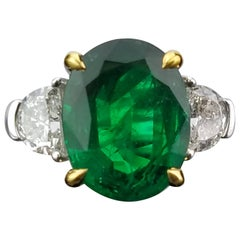 4.9 Carat Oval Shape Emerald and Diamond Three-Stone Ring