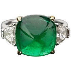 5.06 Carat Emerald Sugarloaf and Diamond Three-Stone Ring