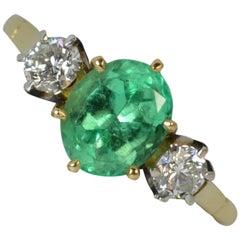1.25 Carat Columbian Emerald and VS Diamond 18 Carat Gold Trilogy Ring