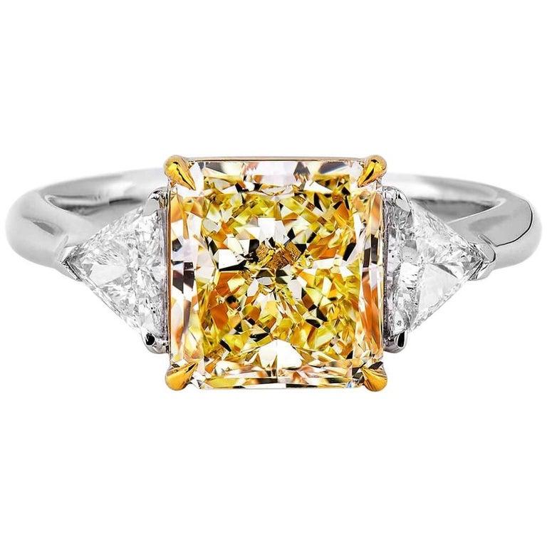 GIA Certified Fancy Light Yellow 3.01 ct  Diamond and 0.47 ct White Diamond Ring