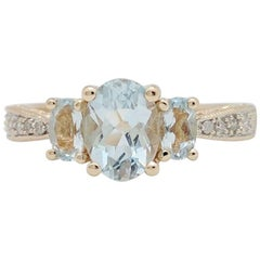 14 Karat Yellow Gold Aquamarine and Diamond Three-Stone Ring