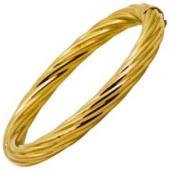 Hollow Twist 18 Karat Yellow Gold Bangle Bracelet