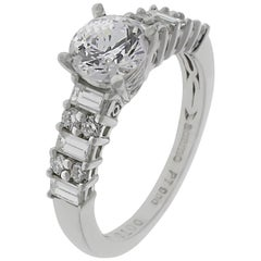 Engagement Ring with Round Brilliant Cut Diamonds and Baguettes