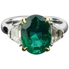 3.95 Carat Oval Emerald and Diamond Three-Stone Ring
