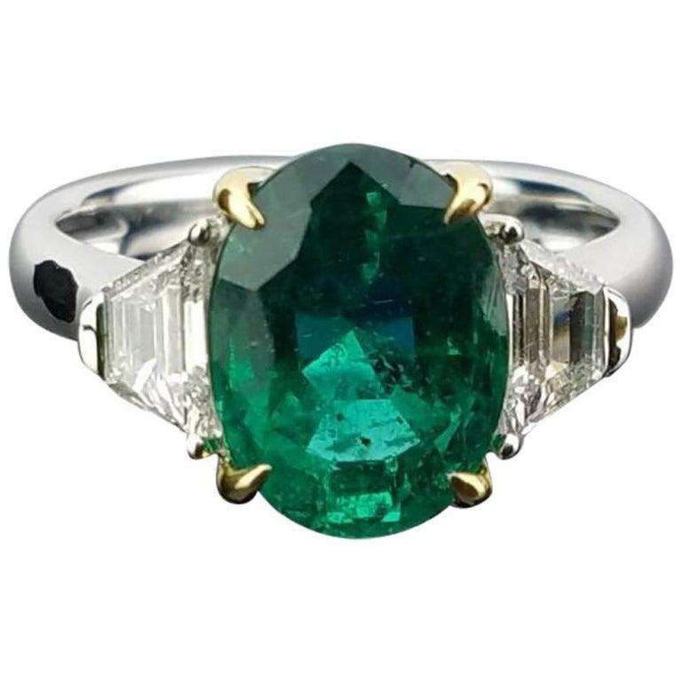 3.95 Carat Oval Emerald and Diamond Three-Stone Ring