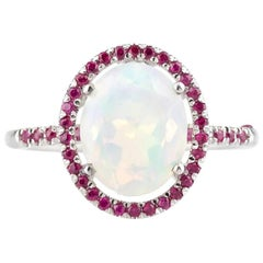 Aurora 14 Karat White Gold Welo Opal and Natural Pave Ruby Ring