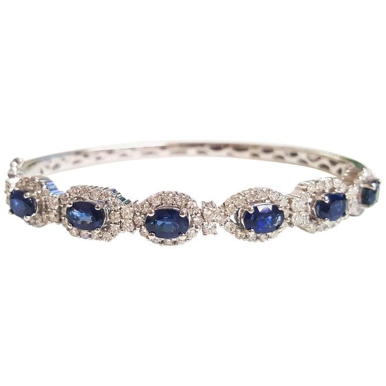 Ladies 14 Karat White Gold Oval Sapphire and Diamonds Bangle