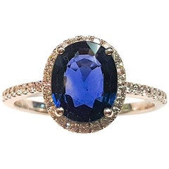 This Ladies 14 Karat White Gold Sapphire and Diamonds Ring