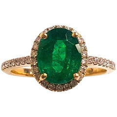 Ladies 18 Karat White Gold Emerald and Diamonds Ring