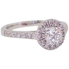 18 Karat Gold Ring with a 0.41 Carat Round Diamond and 0.42 Carat of Diamond
