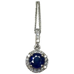 Deep Blue Sapphire and Diamond Round Cut 18 Karat Gold Halo Cluster Pendant