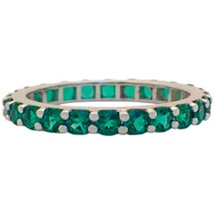18 Karat Gold Eternity Band with Chatham-Created Emeralds Weighing 1.22 Carat