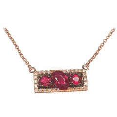Ladies 14 Karat Rose Gold Rubies and Diamond Pendant