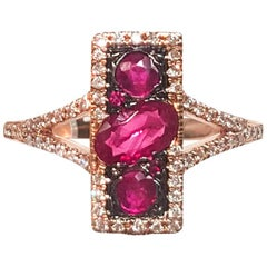 Ladies 14 Karat Rose Gold Rubies and Diamond Ring