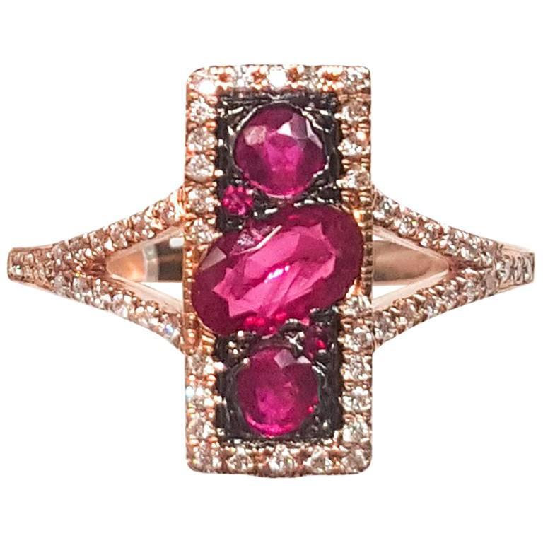 Ladies 14 Karat Rose Gold Rubies and Diamond Ring