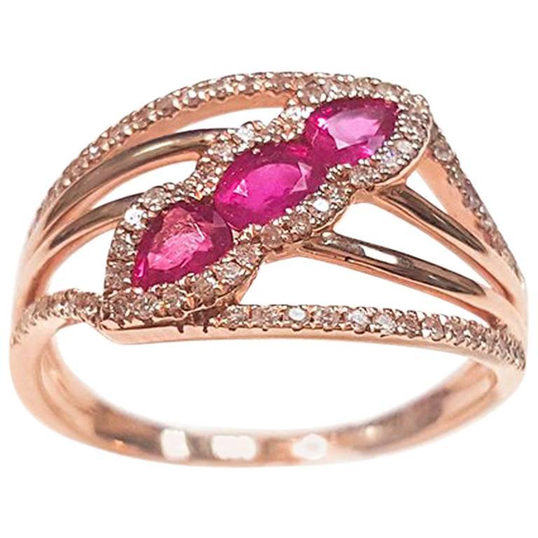 Ladies 14 Karat Rose Gold Rubies and Diamonds Ring