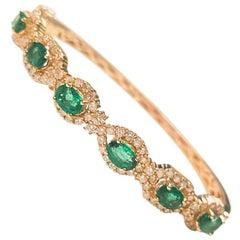 Ladies 14 Karat Yellow Gold Emerald and Diamond Bangle
