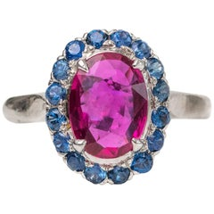 1950s 2 Carat Burma Ruby with Ceylon Sapphire Halo 14 Karat White Gold Ring