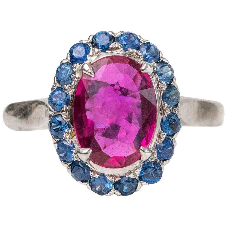 1950s 2 Carat Burma Ruby with Ceylon Sapphire Halo 14 Karat White Gold Ring