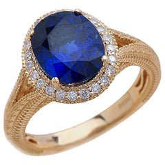 1.50 Carat Oval Cut Blue Sapphire Engagement Ring in 14 Karat Yellow Gold