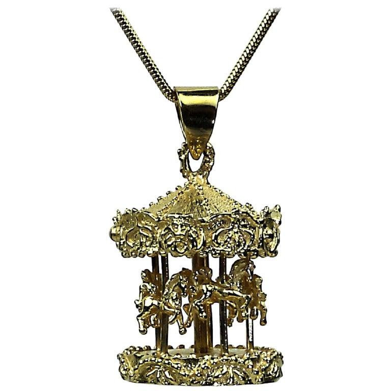 14 Karat Yellow Gold Carousel Pendant