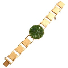 1960s 14 Karat Gold and Jade Bracelet