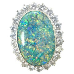 Black Opal Oval Cut 13 Carat Platinum and Diamond Ring