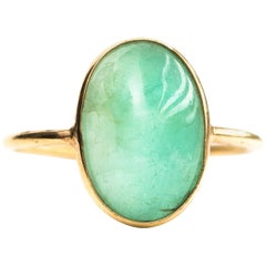 3 Carat Oval Emerald Cabochon and 18 Karat Yellow Gold Ring
