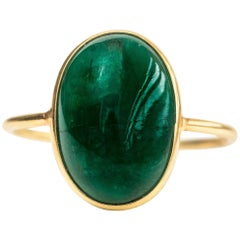 4.5 Carat Oval Emerald Cabochon and 18 Karat Yellow Gold Ring