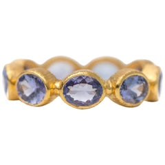 2 Carat Tanzanite and 18 Karat Yellow Gold Eternity Band