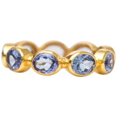 2.0 Carat Tanzanite and 18 Karat Yellow Gold Eternity Band
