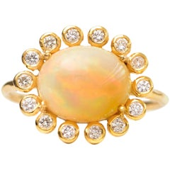 2.7 Carat Opal with Diamond Halo, 18 Karat Yellow Gold Ring