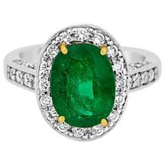 Emerald Diamond Halo Platinum Ring